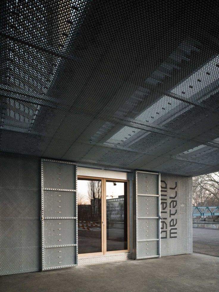 phalt Architekten / Dynamo Metal Workshop. Perforated metal screen facade.