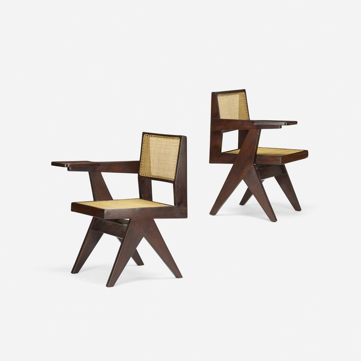 Lot 106: Pierre Jeanneret. pair of writing chairs from Chandigarh. c. 1960, stained teak, cane. 21½ w x 24 d x 32 h in. estimate: $4,000–6,000. Provenance: Chandigarh, India | Private Collection, Paris