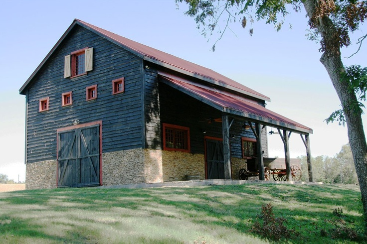 The red on blue/gray gives this restored old barn a nice feel.