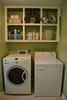 Laundry room makeover home pinterest for Cheap laundry room cabinets