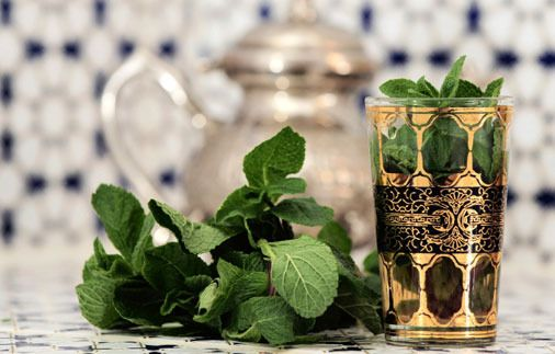 Moroccan Mint tea. Method: Rinse gunpowder green whole tea leaves in hot water and pour off all water. Add more water to pot and too much sugar, simmer for 2 minutes, add a handful of fresh mint. Simmer a minute and serve. Delicious and refreshing !