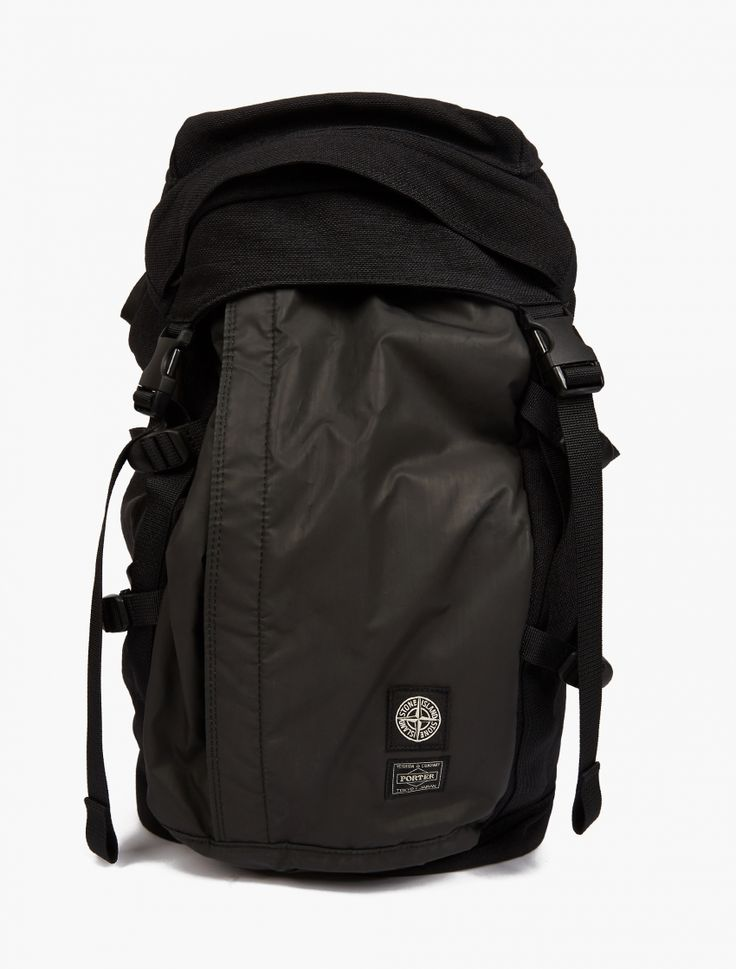 Stone Island X Porter Reflective Backpack | Stone Island's experimental textile department have collaborated with Japanese bag experts Porter to bring you the best in contemporary baggage. The range features a specially devised 'Radiale Esploso' material: a rubber-looking pigmented polyurethane that's particularly reactive to light.