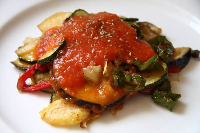 Tumbet Mallorquin- Peppers, potatoes, eggplant, zucchini roasted in olive oil, topped with fresh tomato sauce. Amazing.