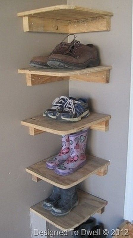 DIY garage / mudroom shoe storage > built in shelves. Mount corner shelves as a clever way to organize shoes and boots.