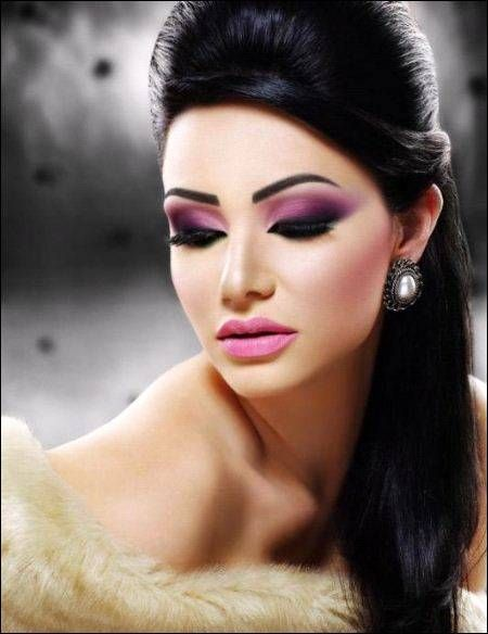 Smoky purple eye makeup and bold black liner. Lilac lips.