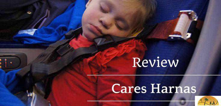 Review: CARES Harnas getest. Ze je kindje in de gordels op een vliegtuigstoel. Onze dochter sliep beter en bovendien zit ze veilig bij turbulentie en het opstijgen en dalen.
