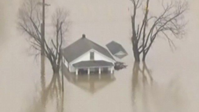 Federal officials were monitoring 19 vulnerable levees on the rising Mississippi River and its tributaries, warning that hundreds of homes in Illinois and Missouri could be threatened by a rare winter flood that already forced the partial closure of interstate highways and widespread evacuations.