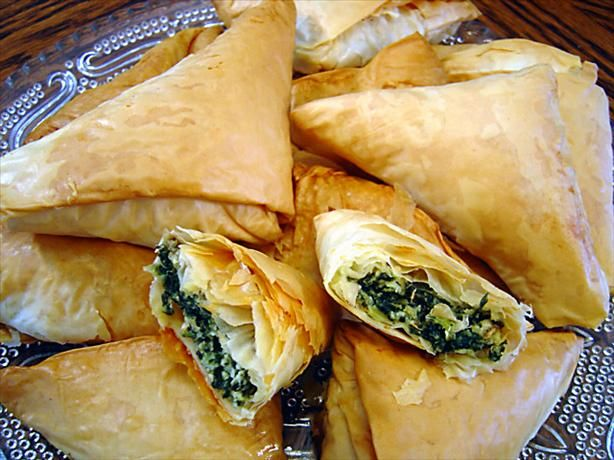 "Spanakopita triangles: ""Watch this tutorial on YouTube http://www.youtube.com/watch?v=u-5rnAWUMO0 Near the end of it the person making the Phyllo unlocks the seceret to perfect Phyllo triangles!"""