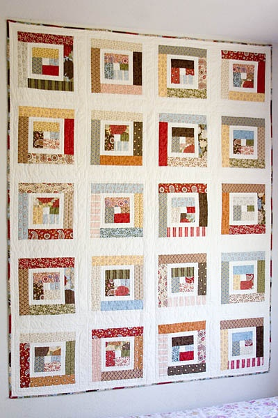 Modern log cabin quilt with link to strip piecing tutorial: