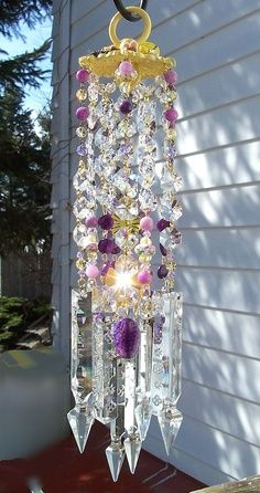 Crystal Wind Chime. Site is removed, so this is just a beautiful inspiration. Any of you CRAFTY guys out there are probably well able to design your version of this Beauty! Just think of the sparkles and rainbows!