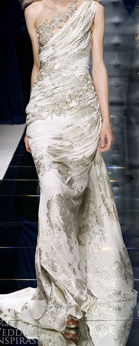 Zuhair Murad, one of my favorite couture designers. This white and silver rouched one shoulder gown is so elegant and would be an amazing gown to wear down the isle. #Zuhair #Murad #couture #designer #wedding #dress #gown #elegant #white #silver