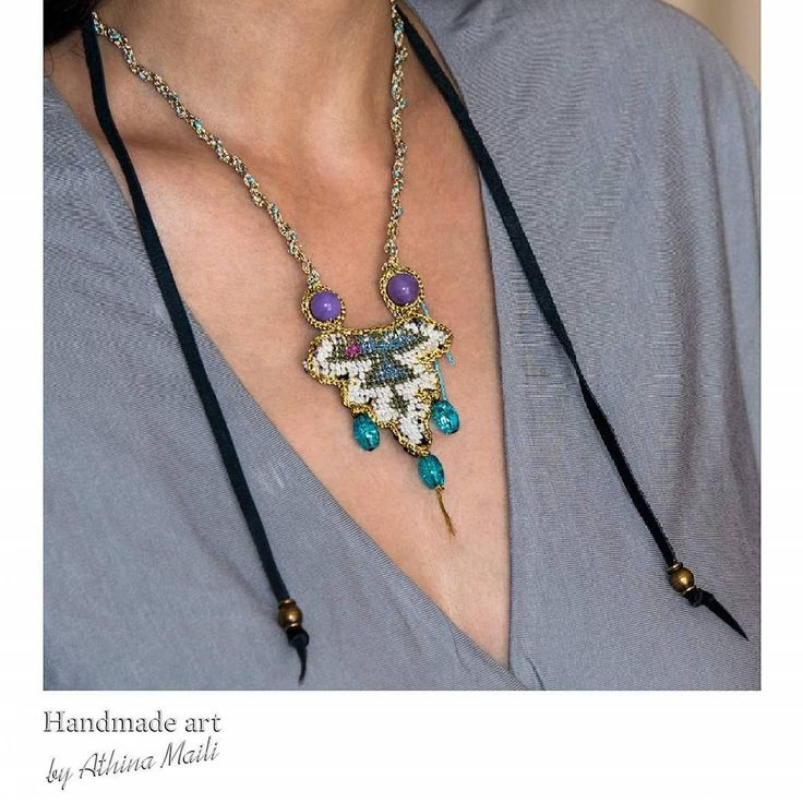 Handembroidered talisman with precious stones, gold threads, leather cords and hand knotted chain