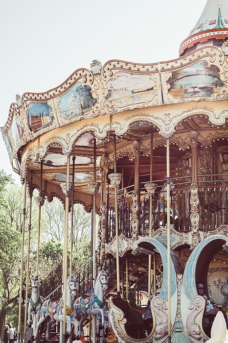 A soft pink photograph of a carousel in the Trocadero region near the Eiffel Tower in Paris, France.