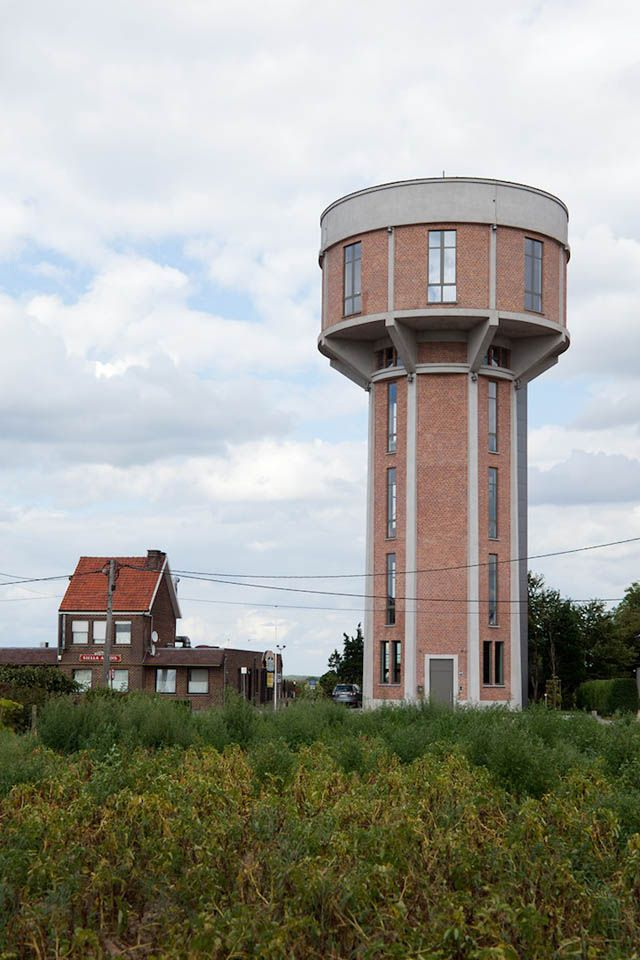 Chateau d'eau is 100-foot-tall Belgian water tower that was recently converted into a single family home. Built in 1938, the brick and concrete tower now houses a 2-car garage, 2 bedrooms, and a si...