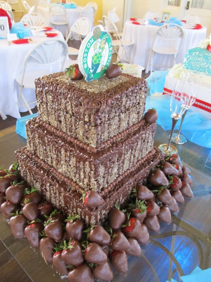 Chocolate rice krispie groom's cake with chocolate covered strawberries.