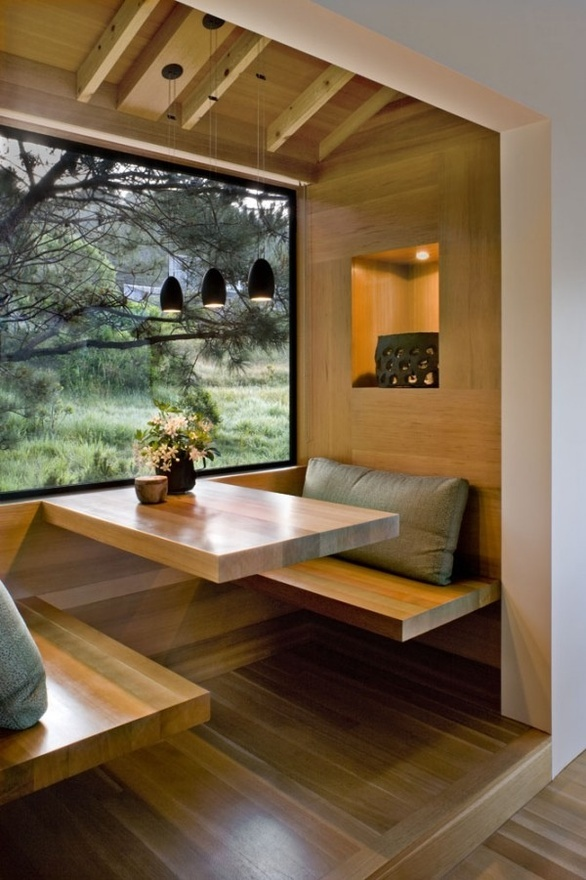Breakfast nook.. kinda love this with the big window view