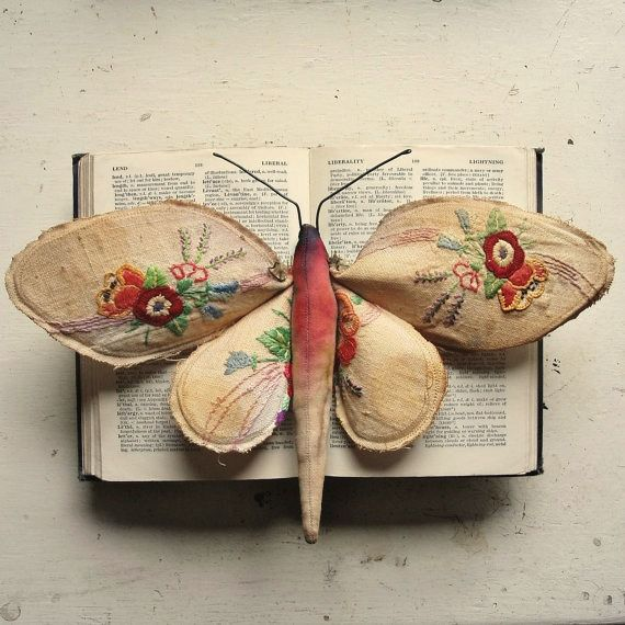 What a Beautilful Little Creation. Perhaps I could use my skirt with the embroidered flowers on it that doesn't fit me anyomore and try and craft something similar. I like how it's displayed on a book - The whole thing could be wall art.  (Mr Finch)