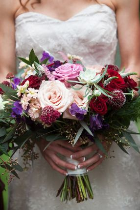 Marsala, Burgundy, Woodland Bridal bouquet.  Black magic roses, Cool water roses, quicksand roses, scabiosa, sweet pea, astlibe, stock.  Photo credit: Lindsey Beckwith Photography