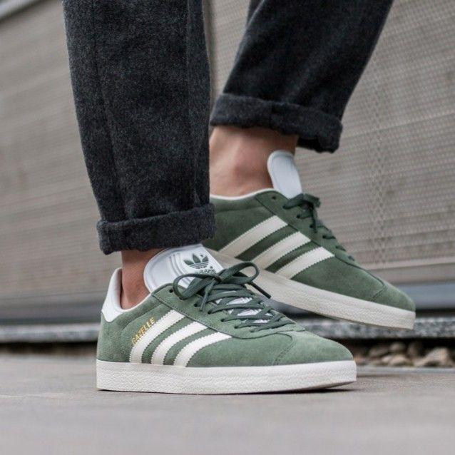 premium selection 053e5 505c1 Trace green adidas Gazelle on feet on the street.