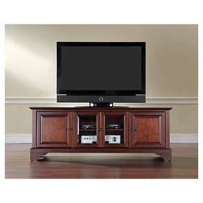 """• Lacquered hardwood<br>• Brass hardware<br>• Adjustable shelves and cord cut outs<br><br>The rich, hand rubbed, multi-step finish of the LaFayette Low Profile TV Stand 60"""" from Crosley makes it a beauty. The TV console has a traditional look with 2 raised panel doors and 2 tempered glass doors to store all your electronics."""