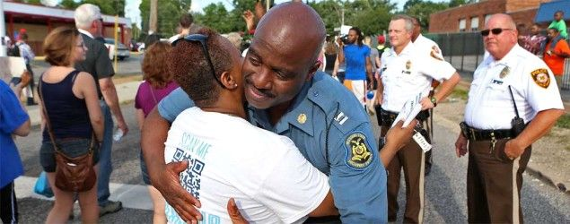 Capt. Ronald Johnson of the Missouri Highway Patrol hugs Angela Whitman, of Berkeley, Mo., on West Florissant Avenue in Ferguson. (AP/St. Louis Post-Dispatch, David Carson) Turmoil and tear gas give way to hugs and hope Peaceful marches follow the governor's decision to shift oversight from local police to state troopers. 'We're being treated with respect'...