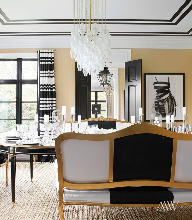 Dining room design with love seat seating and statement hanging light | Megan Winters