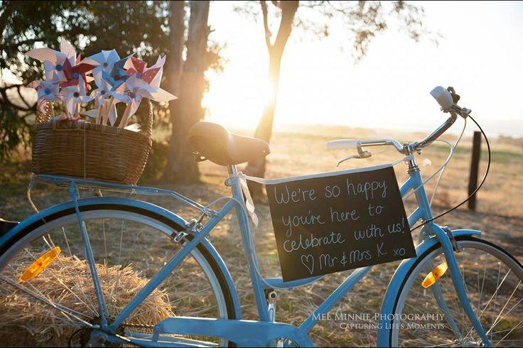 #bluebike #bluevintagebike #pinwheels #vintagewedding #redblue #bikewedding