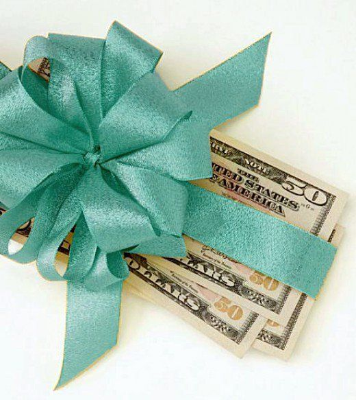 Asking for money as a wedding gift takes just a bit of etiquette, and cash is usually exactly what you need.  Here are five ways to ask for money as a wedding gift while still being polite.