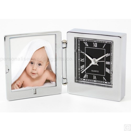 £19.95.Simply open up this Engraved Photo Frame Travel Clock to discover a handy little bedside accessory or travel companion which everyone will love.In the left side, your loved one can insert their favourite 4.5cm x 5cm photo, whilst on the right, there's a very useful small travel clock with an alarm feature - perfect for those early morning calls!To make this an extra special present, you can even have the front of this photo frame travel clock engraved with a personalised message of…