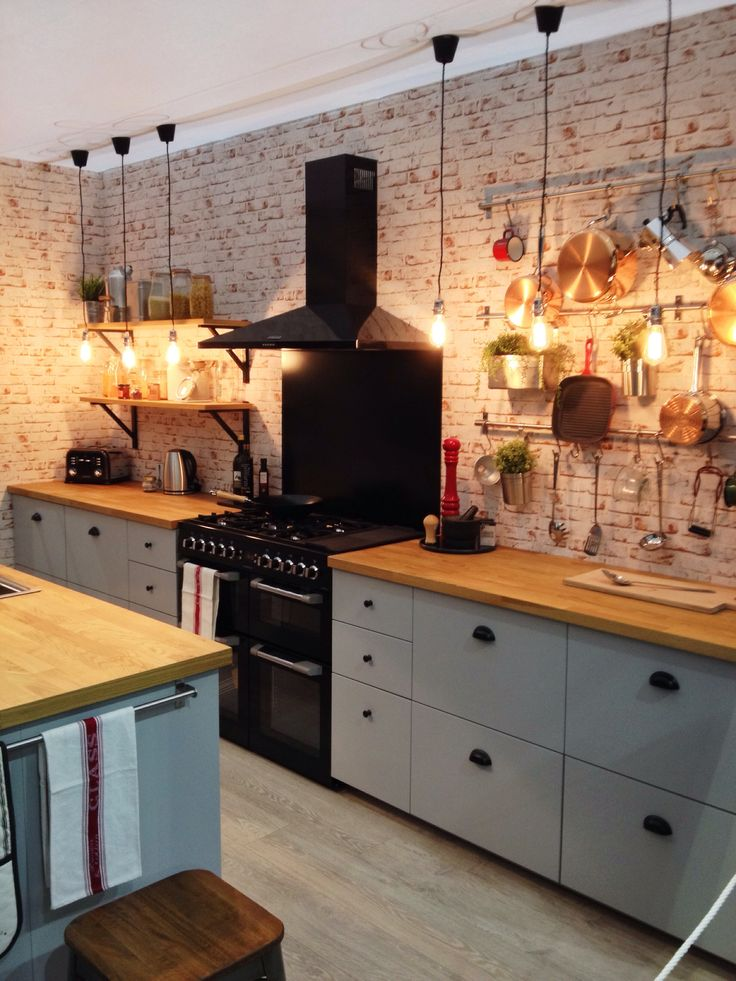 Kitchen inspiration. The brick is actually wallpaper, how clever n fun!