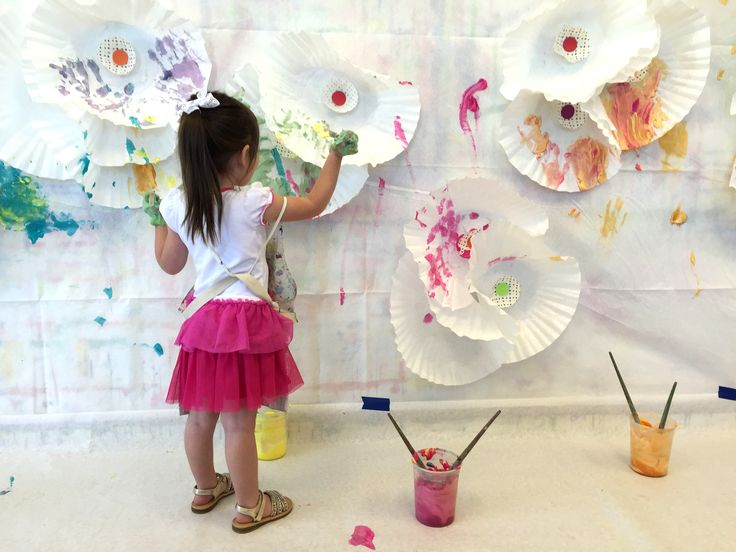fluttery flower wall small hands big art made with large coffee filters glued to