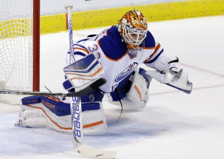 Edmonton Oilers goalie Cam Talbot (33) dives for a save against the Florida Panthers during the third period of an NHL hockey game, Monday, Jan. 18, 2016, in Sunrise, Fla. The Oilers won 4-2. (AP Photo/Alan Diaz)