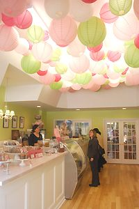 I love the latterns hung at The Vanilla Pastry Studio in Pittsburgh, PA.  They are simply lit from above by the existing lights in the ceiling. The different sizes and colors make it whimsical!