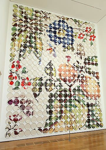This is made of dinner plates, but would be a cool idea for a quilt.   Mosaic pixeled plates