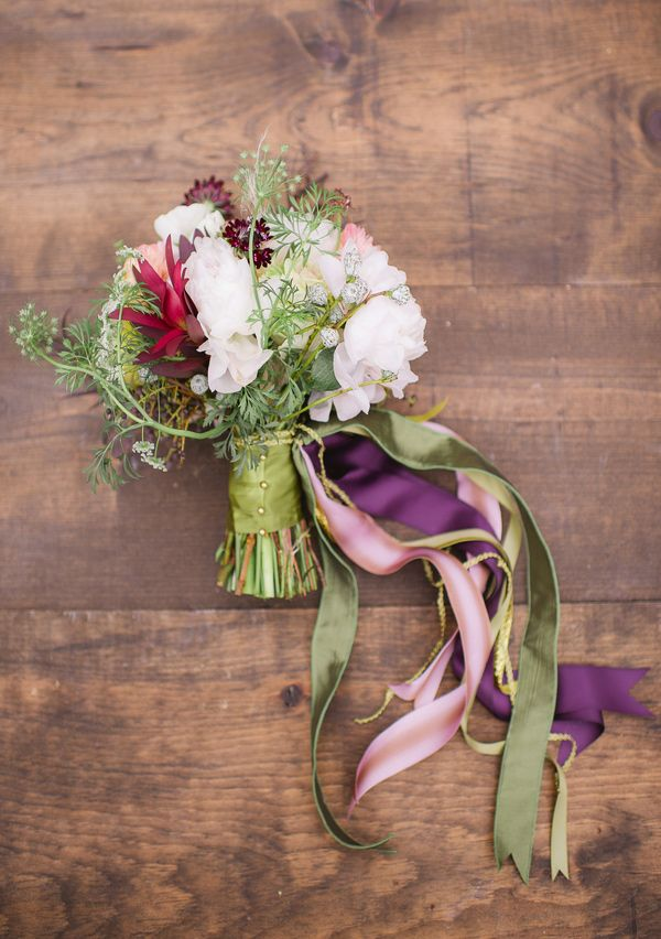 ribbon wrapped bouquet, photo by Julie Paisley http://ruffledblog.com/cotton-field-winter-wedding-ideas #flowers #ribbon #wedding
