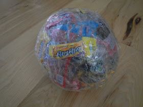 Taped candy ball game to keep the kids busy during the Christmas party. : )