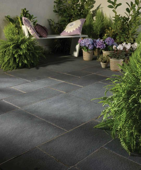 Bradstone Natural Limestone paving lends a smooth and sophisticated feel to any contemporary garden.