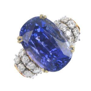 LOT:495 | A Ceylon sapphire and diamond dress ring.