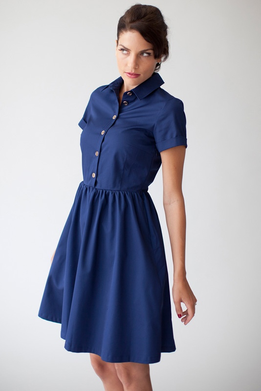 Dress Natasja in dark blue with golden buttons.