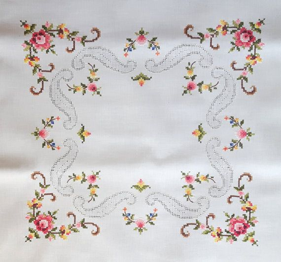 Vintage handmade tablecloth with cross stitch roses