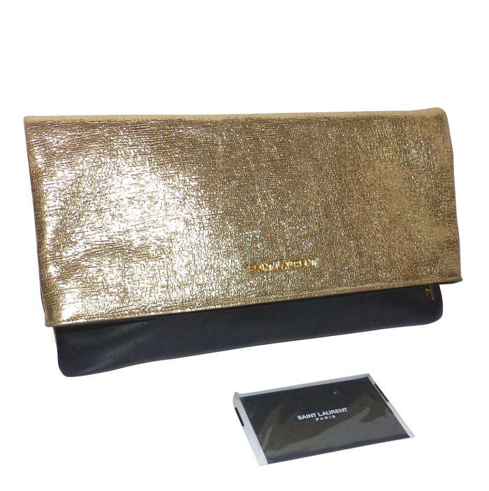 depot vente de luxe en ligne yves saint laurent grande pochette en cuir doré et noire | TendanceShopping.com