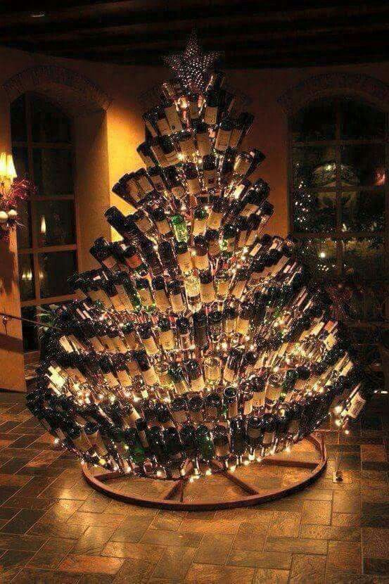Wine bottle Christmas tree.... I know a few folks who could make this happen