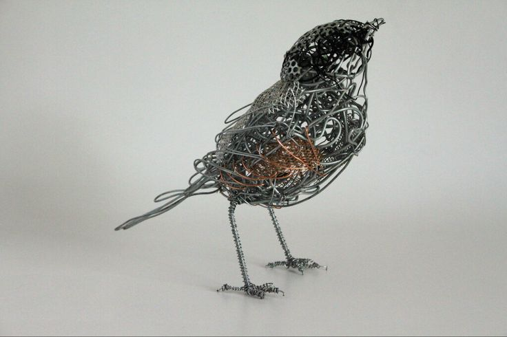 wire bird sculpture... maybe people in art could create things out of wire to decorate the eco garden???