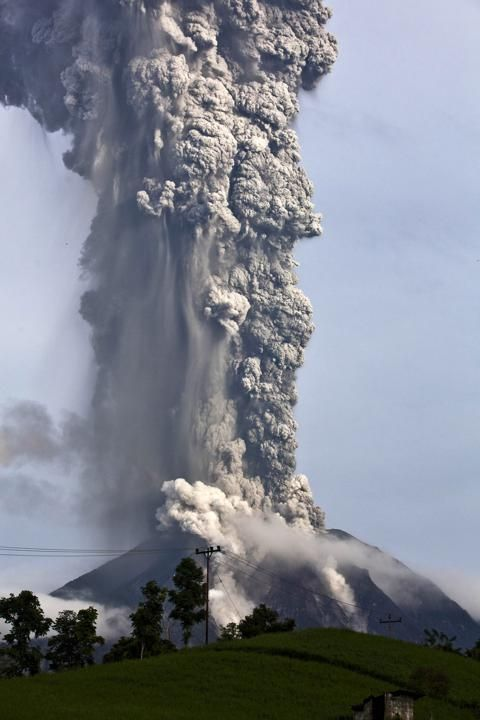 Mount Sinabung spews pyroclastic smoke as seen from Tigapancur village in Karo district on November 14, 2013 in Medan, Sumatra, Indonesia. Up to 4,300 residents have been evacuated from five villages in North Sumatra due to the volcanic eruptions of Mount Sinabung.