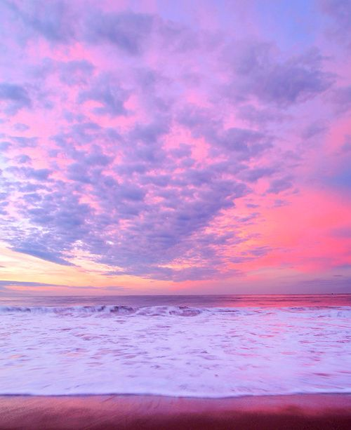 A violet and tangerine sky over the ocean