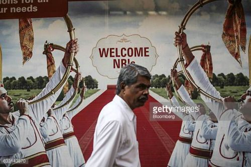 04-27 A pedestrian walks past an advertisment for ICICI Bank... #icici: 04-27 A pedestrian walks past an advertisment for ICICI… #icici