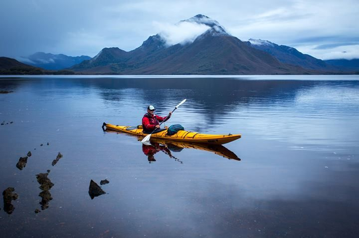 Kayaking on Bathurst Harbour, Tasmania ~ Bathurst Harbour is an almost landlocked harbour providing safe anchorage from the Roaring 40's for many a sailor over time