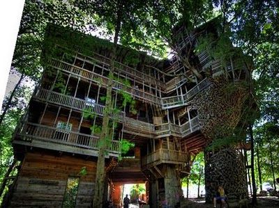 How do I not know about this cool stuff in IA? 12-level treehouse near Marshalltown, Iowa, has over 5,000 square feet of floor space, plus a telephone, a microwave, a fridge, running water, 13 porch swings, a spiral stairway and a grill.