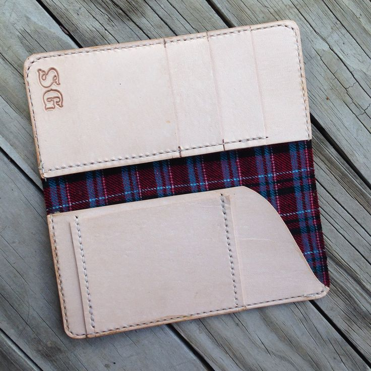 Tall horween Chromexcel wallet with veg tan interior and plaid lining.