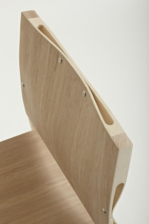 Squeeze is a minimalist design created by Rhode Island School of Design graduate Nic Wallenberg. The design is an asymmetric joint that lets straight timber bend. Utilising the unique degree of flexibility that is inherent in Hickory (a popular species of wood for bow making), asymmetrically positioned slots are machined through the thickness of the timber around the frame, the seat and the back. (2)